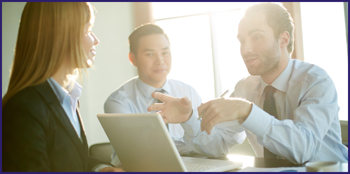 Portrait of three smart business partners communicating at meeting